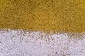 Dark yellow and white rustic plastered wall — Stock Photo