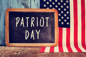 Text Patriot Day in a chalkboard and the flag of the United Stat — Stock Photo
