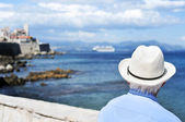 Old man looking at the sea in Antibes, France, filtered — Stock Photo