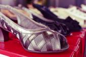 Woman shoes on sale in a street market — Stock Photo