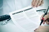 Young woman signing an informed consent — Stock Photo