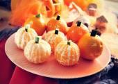Mandarines ornamented as Halloween pumpkins — Stock Photo