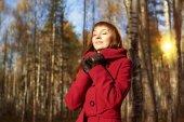 Young woman on autumn  garden background — Stok fotoğraf