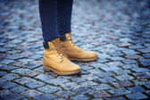 Womens feet in yellow boots — Photo