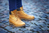 Feet in yellow boots — Stock Photo