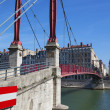 Lyon city with red footbridge — Stock Photo #54340103