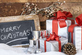 Gifts with lighted candles — Stock Photo