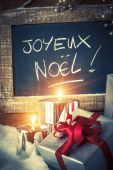Closeup of Christmas gifts with candles — Stock Photo