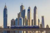 Dubai with subway and skyscrapers — Stock Photo