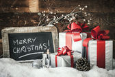 Closeup of Christmas gifts with candle — Stock Photo