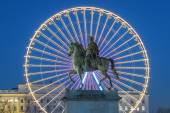 Place Bellecour, famous statue of King Louis XIV and the wheel — Stock Photo