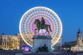 Place Bellecour, famous statue of King Louis XIV by night — Stock Photo