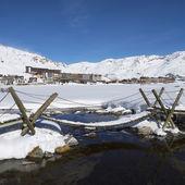 Tignes village with footbridge — Stock Photo