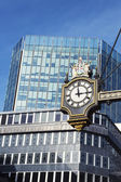 Clock and buildings — Foto Stock