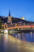 View of Lyon and red footbridge — Stock Photo