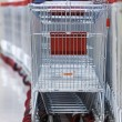 Row of Stacked Supermarket Trolleys — Stock Photo #82617374