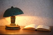 Old lamp and book — Stock Photo
