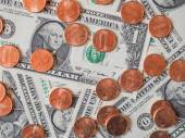 Dollar coins and notes — Stockfoto