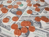 Dollar coins and notes — Stock Photo