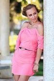 Blonde Woman Posing In Pink Dress — Stock Photo
