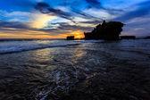 Tahah Lot Temple and ocean waves at sunset, Bali — Stock Photo
