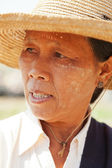 Burmese woman in typical hat — Stock Photo
