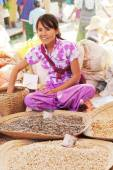 Young Burmese woman selling nuts — Stock Photo
