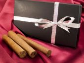 Three Cigars with a Gift — Stock Photo