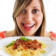 Young woman eating spaghetti — Stock Photo #62145117
