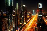 Dubai skyline at night — Stock Photo