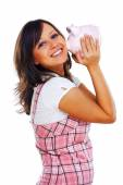 Woman holding pig money-box — Stockfoto