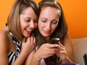 Young women looking at  cellphone — Stock Photo