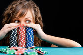 Young woman with gambling chips — Stock Photo