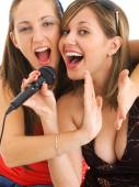 Girls singing Karaoke — Stock Photo