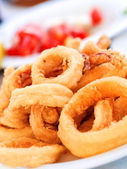 Fried squid in a greek restaurant — Stock Photo