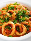 Squids stewed in tomato — Stock Photo