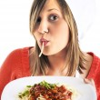 Young woman eating spaghetti — Stock Photo #62195209