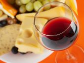 Cheese with grapes and glass of wine — Stock Photo