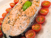 Salmon steak with cherry tomatoes — Stock Photo