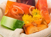Spa Products with soaps and flowers — Stock Photo