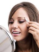 Woman Applying  make-up — Foto Stock