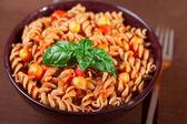 Fusilli pasta with chick-peas — Stock Photo