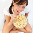 Young woman eating popcorn — Stock Photo #62396415