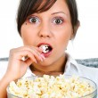 Young woman eating popcorn — Stock Photo #62396539