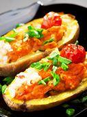 Stuffed potatoes with tomatoes — Stock Photo
