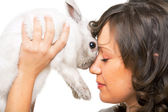 Young woman kissing rabbit — Stock Photo