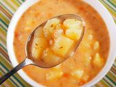 Potato soup with spoon — Stock Photo