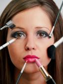 Applying make-up on woman face — Stock Photo