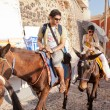 Постер, плакат: Tourists enjoying ride on donkey