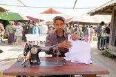 Burmese man sewing clothes — Stock Photo